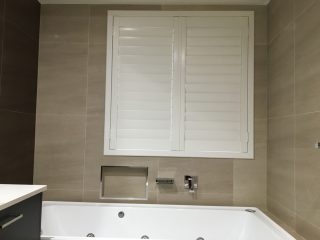 shutters above bath