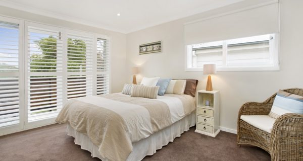 white timber shutters in bedroom