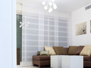 Need window coverings for your sliding door? Panel blinds are a great option
