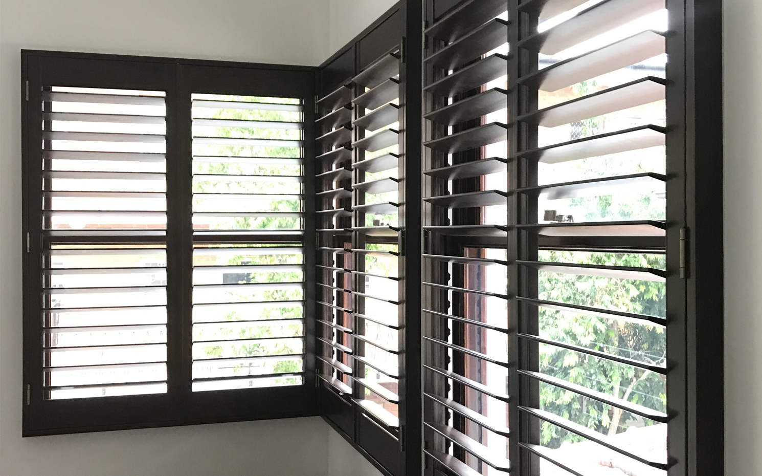 timber plantation shutters in dark wood